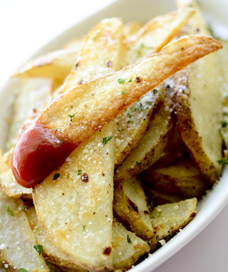 Garlic Parmesan Fries -  these fries are baked in the oven and loaded with flavor!