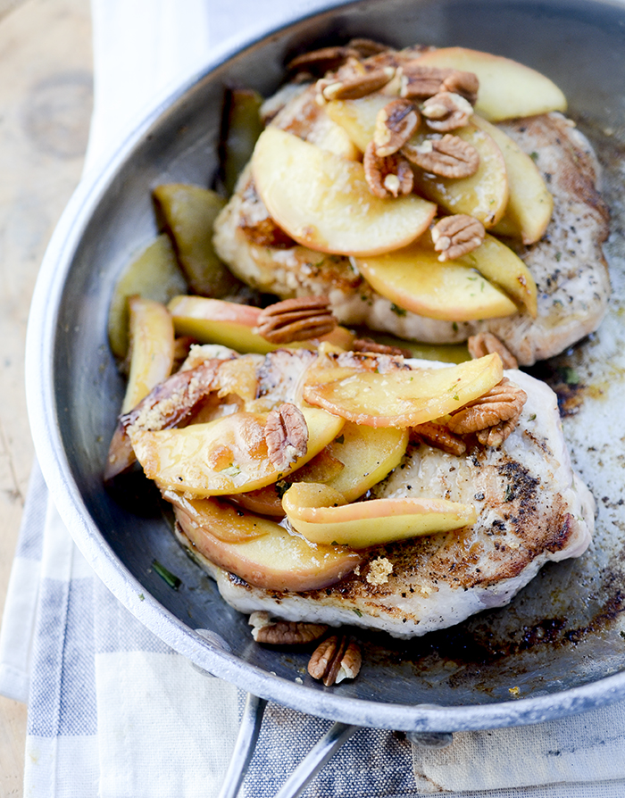One Skillet Pork Chops and Apples - Apples and Pork Chops cooked together in one skillet and topped with pecans and maple syrup! Hardly no clean up necessary.