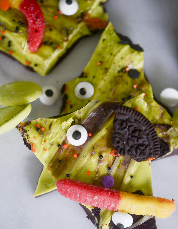 Halloween Monster Bark - melted chocolates topped with candy, sour gummys, and crushed oreos!
