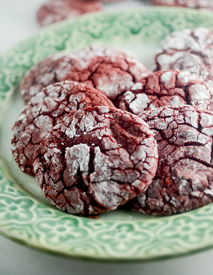 Red Velvet Crinkle Cookies - these cookies are made with a box cake mix and rolled into powdered sugar! The perfect cookie to make when you need to make something fast for the Holidays!