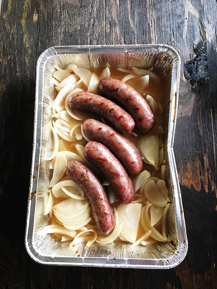 Beer Brats - German Sausages submerged in onions and beer and cooked on the grill. These are a classic Summer time treat in the Midwest!