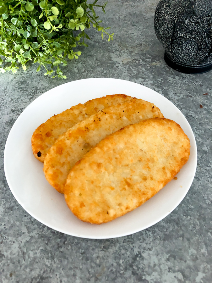 Frozen hash brown patties are simple to cook in your air fryer and they are so crispy on the edges. No oil needed to make these!